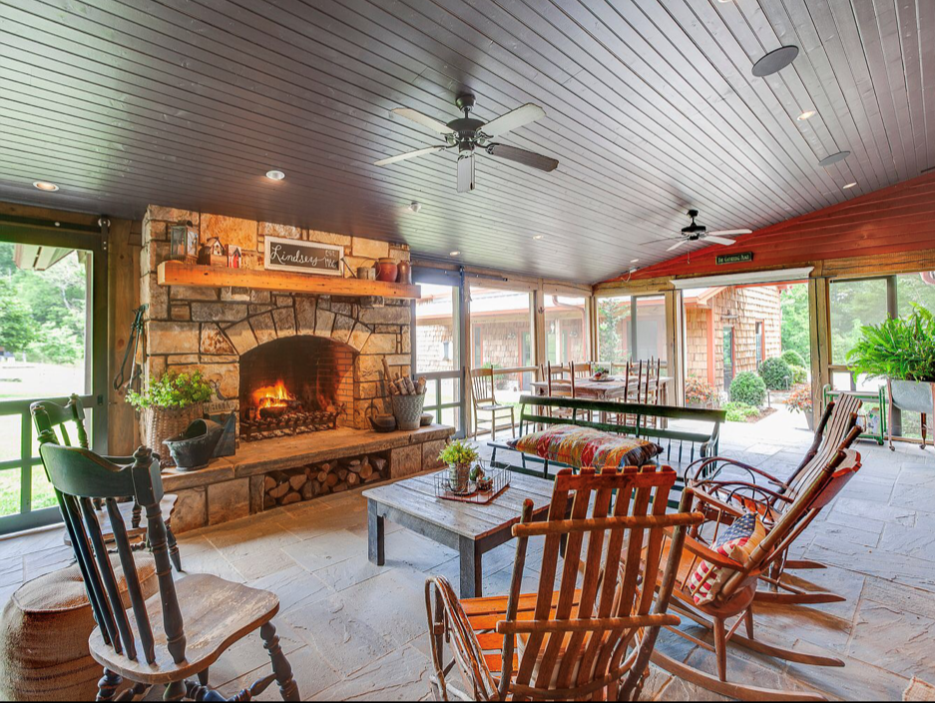 photo of screened in porch with fireplace